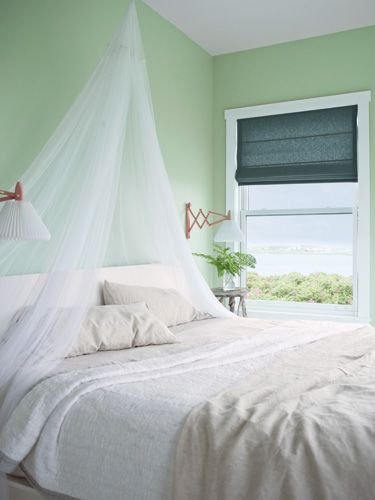 Benjamin Moore's Van Alen Green creates a calming oasis in the bedroom. #countryliving
