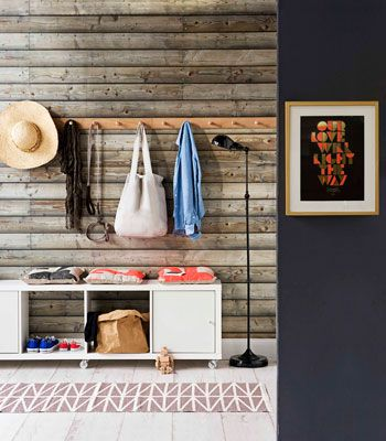 Entryway ideas; like the simple row of hooks and seated storage area with cushions.