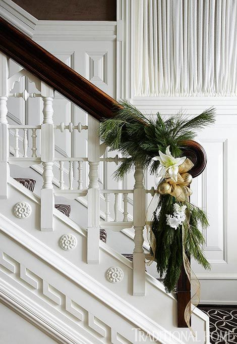 White lily, tulip and hyacinth and gold ribbon really kick the holiday greenery up a notch. Traditional Home® / Photo: Werner Straube
