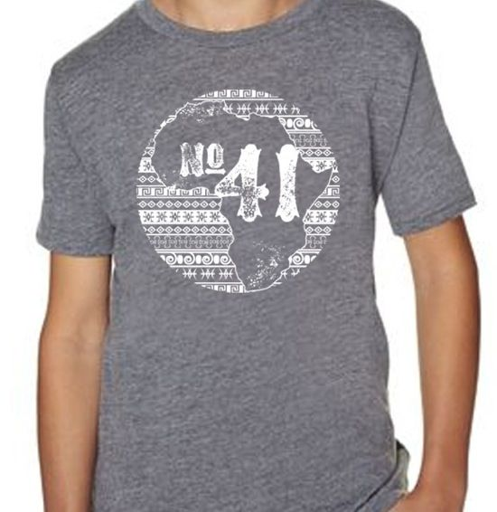 No.41 KIDS TEE!! This tee proves you're never too young to change the world. Looking good and providing 68 lunches to a secondary student in Rwanda, we'd say that's a great place to start.