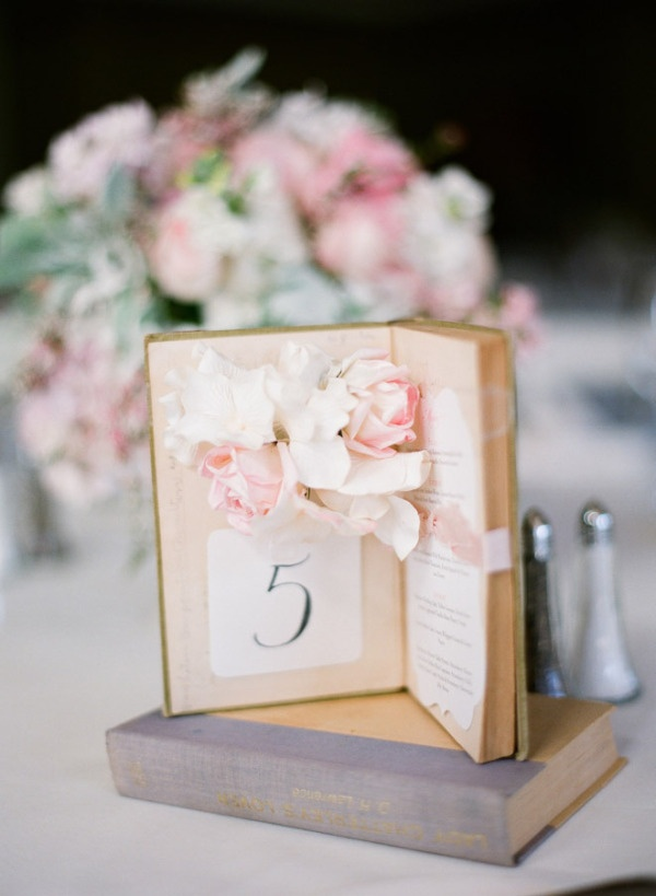 Open book, flowers, and calligraphy. Fabulous table number idea. Photography by austinwarnock.com,