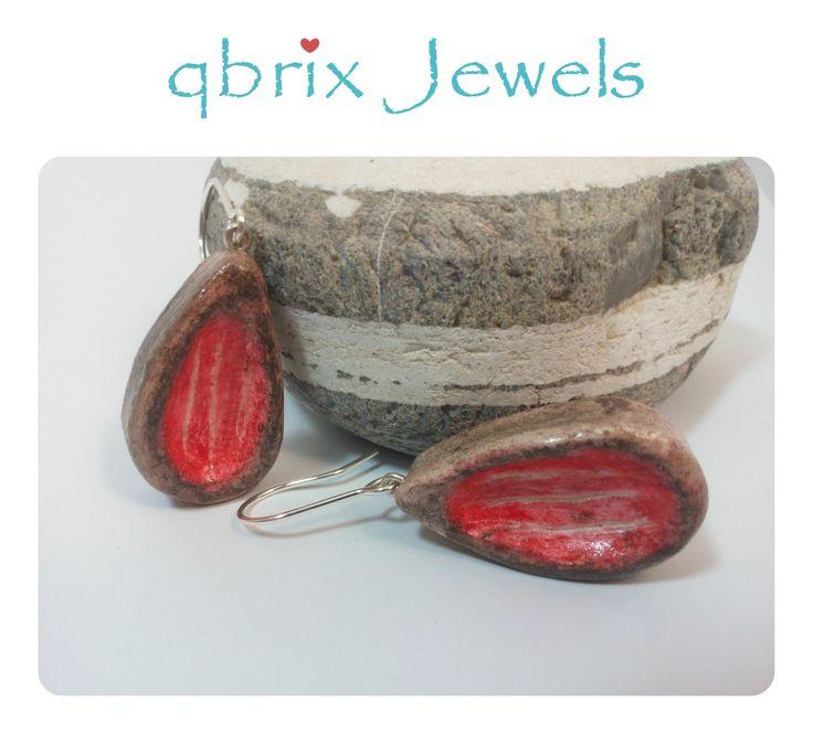 Handmade teardrop earrings of clay