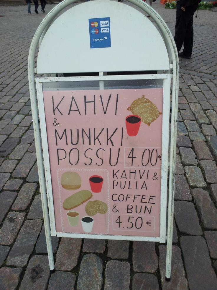 Kahvi & Munkki Possu sign near the old market hall in Helsinki.