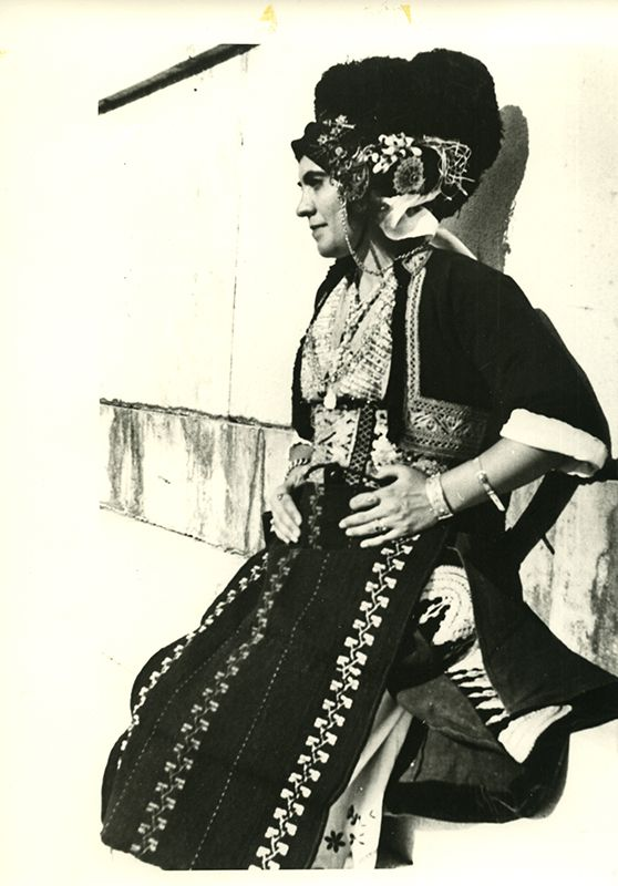 A woman wearing the bridal costume of Gidas, Imathia, Macedonia, in the Panathenaic Stadium, Athens. Photo: Nelly's. Late 1930s ©Peloponnesian Folklore Foundation, Nafplion, Greece