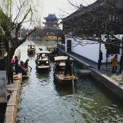 The canal of zhujiajiao with old buddhist temple as background