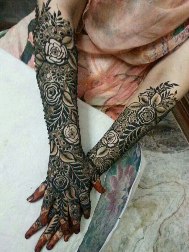 "Gorgeous...mehndi, Arabic, full, lush, and ornate...believe that's black ""henna"" (not true henna and dangerous) unfortunately. .breathtaking design though"