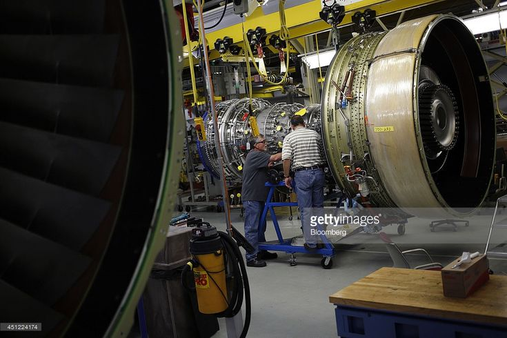 Workers assemble a General Electric Co. CF6-80C2 jet engine at the GE Aviation factory in Cincinnati, Ohio, U.S., on Wednesday, June 25, 2014. The Institute for Supply Management (ISM) is scheduled to release U.S. manufacturing figures on July 1. Photographer: Luke Sharrett/Bloomberg via Getty Images