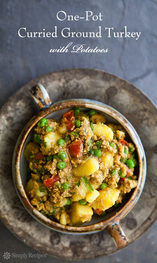 One-pot Curried Turkey. So EASY! Perfect for a midweek meal. Ground turkey sautéed with onions and garlic, then simmered with Indian seasonings, potatoes, tomatoes, and peas. So good! On SimplyRecipes.com