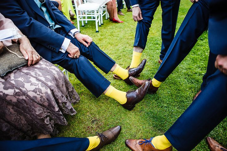 Yellow socks, tan brogues & blue laces for groomsmen - Image by Lina and Tom Photography - An outdoor DIY wedding ceremony in Cambridgeshire England with bright blue colour scheme, huge balloons, many rustic home made touches, dress by Allure Bridals