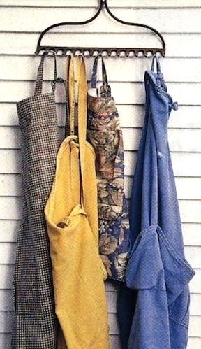 Recycling Old Garden Rakes by hanging your old gardening aprons.
