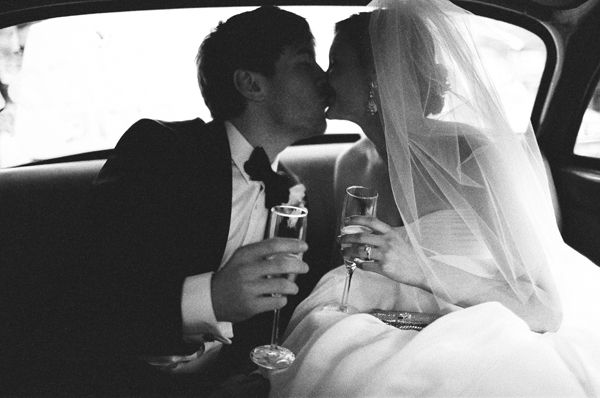 Black Tie Wedding by Bryce Covey:  Bride & Groom toast and share a kiss after nuptials.