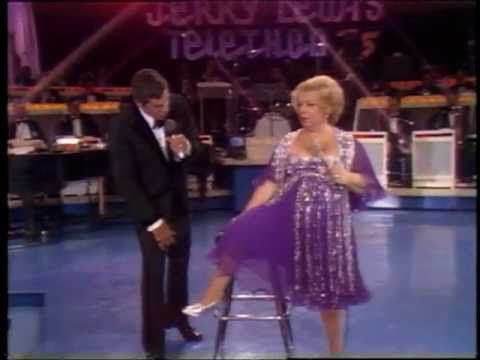 American comedienne Totie Fields jokes around with host Jerry Lewis during the 1975 MDA Telethon.
