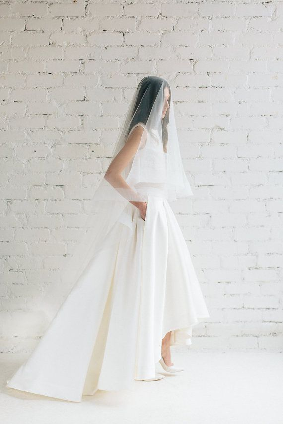 Two piece wedding dress Lily. Skirt . Full pleats luxurious ivory Mikado skirt featuring high-low hem cascades into a subtle train. Perfect for bride prefering to show Your shoes ! Skirt is pretty heavy but very comfortable to wear ! - side pockets; - zipper at the back ; Lily skirt