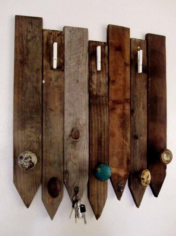 Coat rack using old door knobs and fencing
