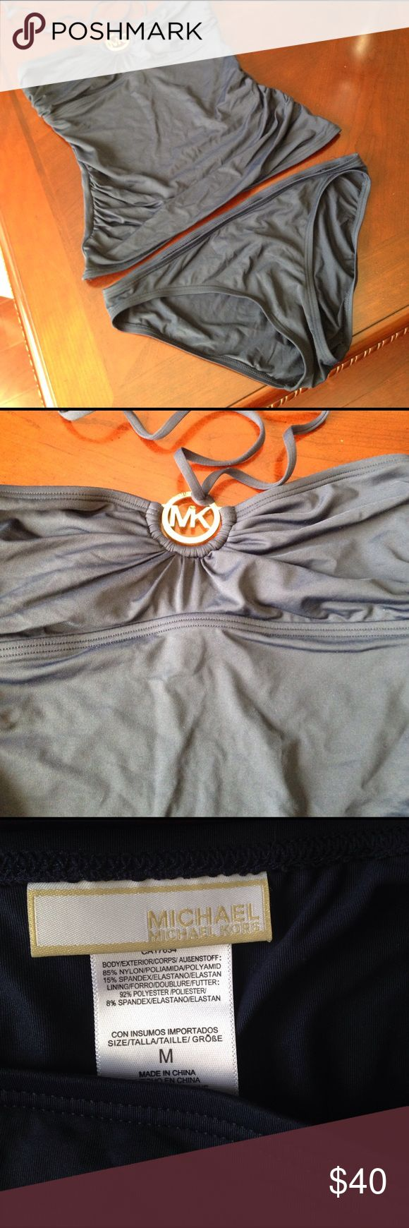 Michael Kors Navy Swim Suit Worn Once , beautiful navy suit, gold logo free of scratches . I cut tag off Top because it was huge and would stick out. Michael Kors Swim Bikinis