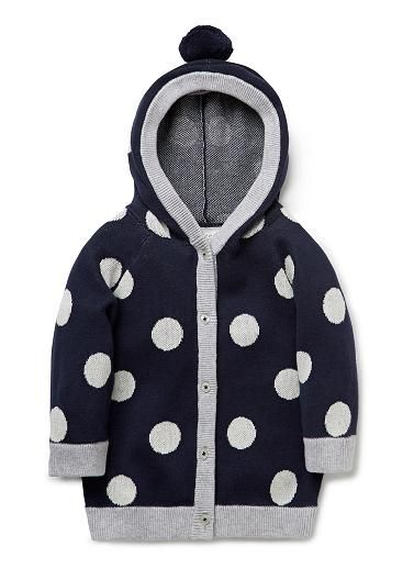 100% Cotton Cardi. Fully fashioned knit cardigan with hood. Feautures all-over jaquard spot,with contrast marle trims and pompom on hood. Regular fitting silhouette. Available in Darker Marshmallow.