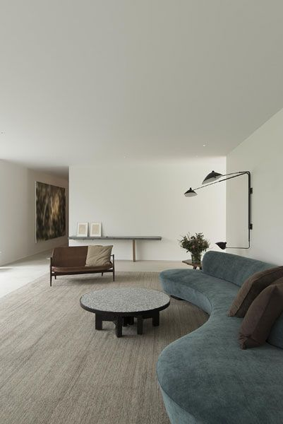 Wonderful curved charcoal grey sofa and the light fitting is stylish and functional.