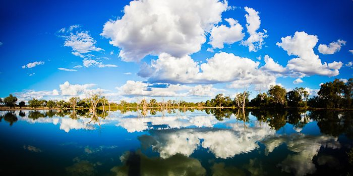 Cloudy Water  Warren, NSW Australia    Cumulus clouds linger over the water reservoir which provided a mirror-like reflection.