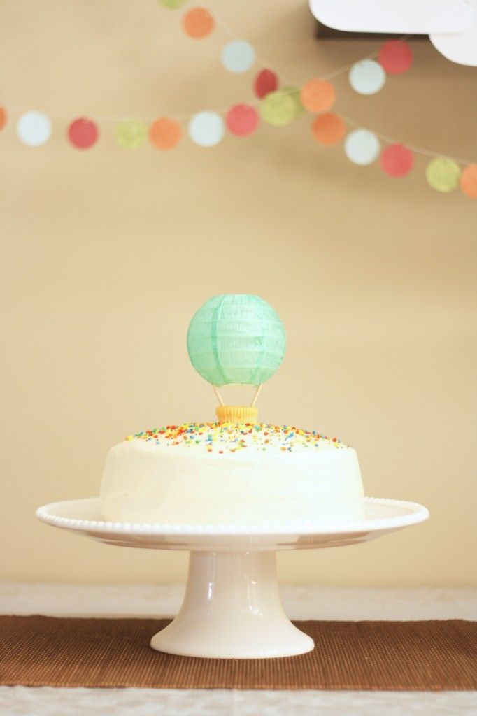 hot air balloon cake using a mini paper lantern...imagine how adorable a whole string of them would be!