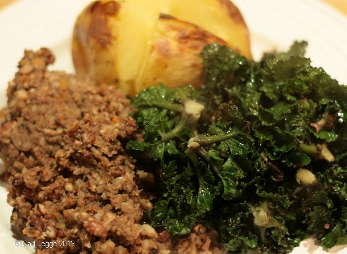 Vegetarian haggis served with flower sprouts and a baked potato
