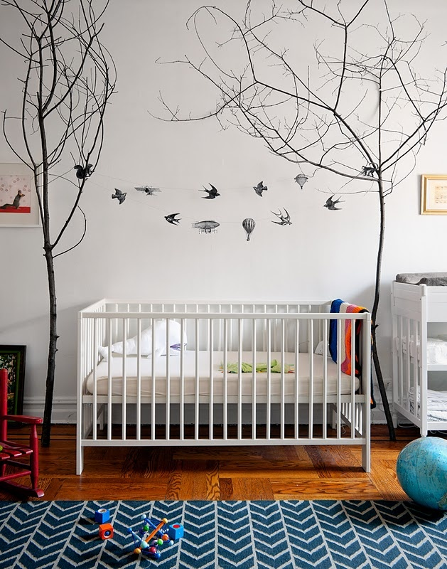 Not the crib, obviously, but the trees and the string between them.  Instead of wall art--maybe stings lights and add interesting shapes.