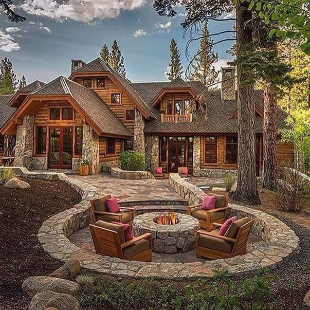 Beautiful stone patio and fire pit.  Love the dug out area and style.