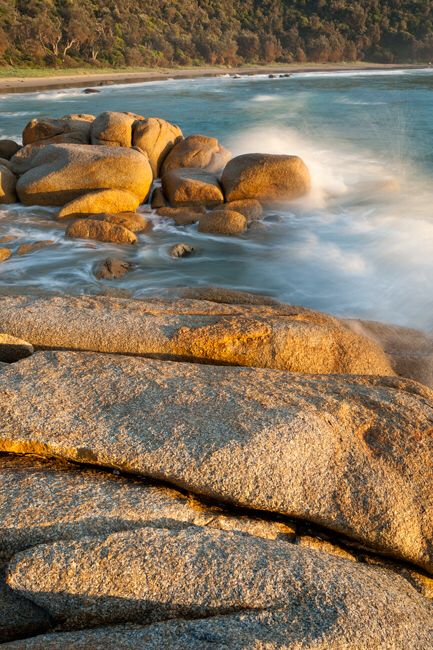 Croajingolong National Park, Victoria Granite boulders catch the morning waves and sunlight. http://www.paulsinclairphotography.com.au/gallery_629273.html#photos_id=13420722