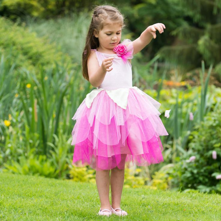 Rose Petal Fairy ~  This pretty pink fairy fancy dress costume has a soft velour bodice with spaghetti straps and a scalloped multi layered net skirt in a multitude of pink shades.  It is finished by a pretty glittered rose and net corsage with green satin petal detail at the shoulder. 3-5 years and 6-8 years  £26.00