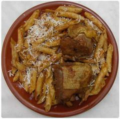Pastitsada! This is the original recipe I learned from my grandmother, Irini. Go heavy on the onions and the oil, this is NOT a light dish! Take 1 kg of rooster or beef, cut it in portions and fry it in a pan in olive oil until it is golden brown. Take the meat out of the pan...