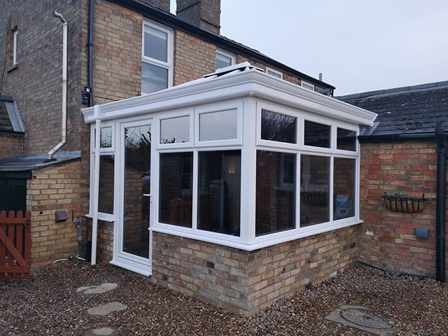 Stage 2 Complete Of Our Brand New Conservatory Plastic Doors Windows And Tinted Glass Have Been Fitted Windows And Doors Holiday Cottage Roof Vents