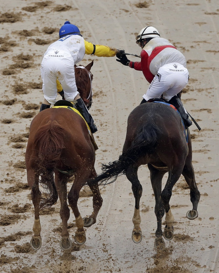Joel Rosario, right, riding Orb is congratulated by Robby Albarado riding Golden Soul after Orb won the 139th Kentucky Derby at Churchill Downs Saturday, May 4, 2013, in Louisville, Ky.