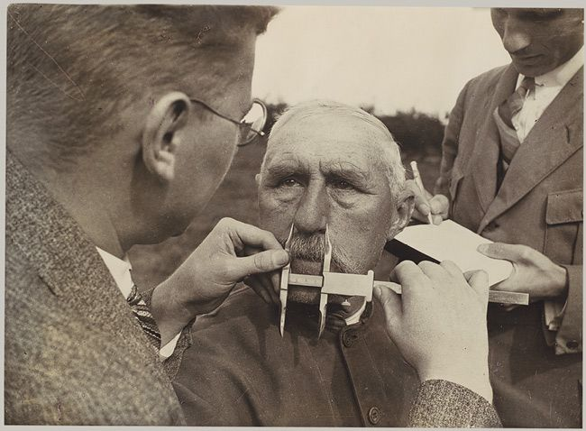 """This photograph, which illustrates the adaptation of physiognomic measurement by Nazi """"race scientists,"""" was published on the cover of the Neue Illustrierte Zeitung on June 1, 1933, above the headline: """"Who Is an Aryan? A Fascist Experiences the National Revolution."""""""