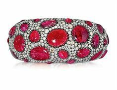 A SPINEL AND DIAMOND BANGLE, BY ANDRÉ MARCHA Of bombé design, set throughout with a series of spinel cabochons within a micro pavé-set diamond surround, 16.0cm inner circumference With maker's mark for André Marcha Price Realized $22,500 Set Currency Estimate $18,000 - $25,000