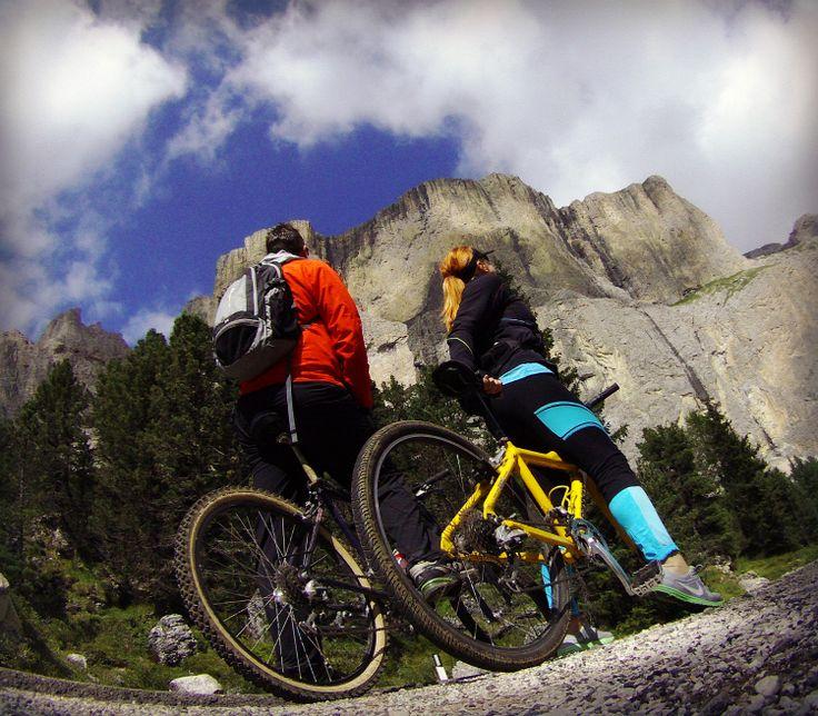Biking down from Passo Sella. View to  Piz Ciavazes mountain wall.  #Italy #Dolomites #Passo Sella #MTB-biking #mountains #Piz Ciavazes #travel