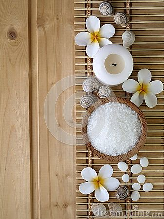 Shells,salt and tiare flowers on the wooden background