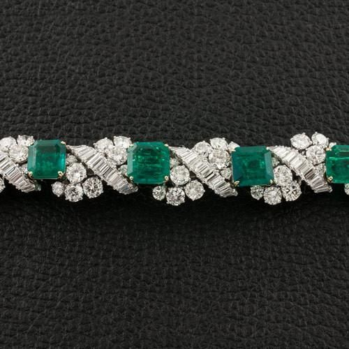Square emeralds and emerald cut and round diamonds set in platinum in this straight bracelet.