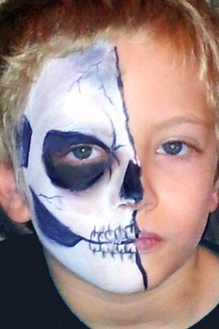 Half Skeleton face paint for Halloween. Done with DFX white and black, with some Starblend black powder for shading.