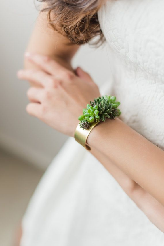 Stunning statement bracelet made with real, live succulents. The brass base is made in the USA, and is one size fits all. Each succulent is