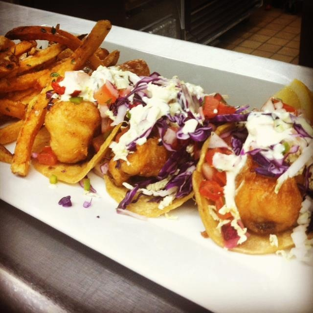 IPA beer battered sea bass tacos with a jalapeño white sauce, shredded cabbage and pico de gallo, served with our housemade yukon gold fries. #tacotuesday