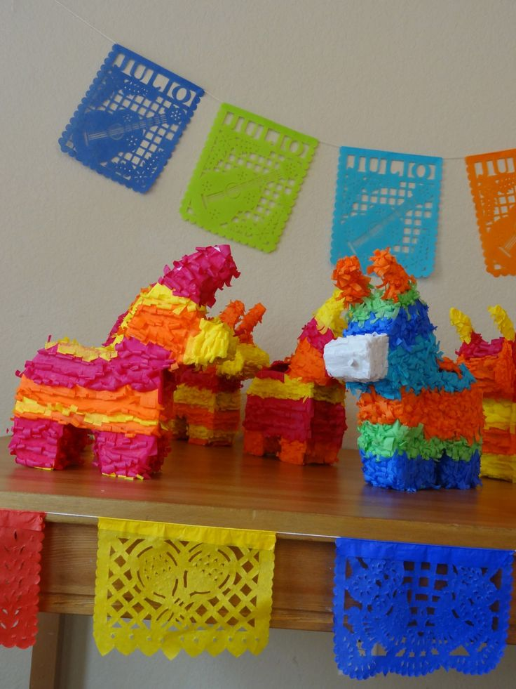 5 Mini Donky piñatas 8x10x2 for a fiesta party as a centerpiece or party favor to fill with candy instead of goody bag Cinco de Mayo. $40.00, via Etsy.