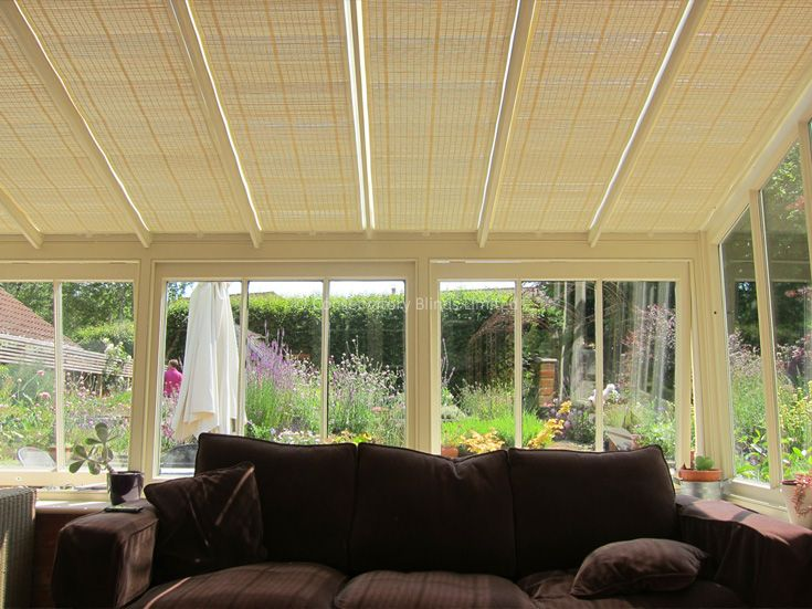 The pure™ Pinoleum roof blinds help keep this lean-to conservatory cool, while still keeping the view of the garden.