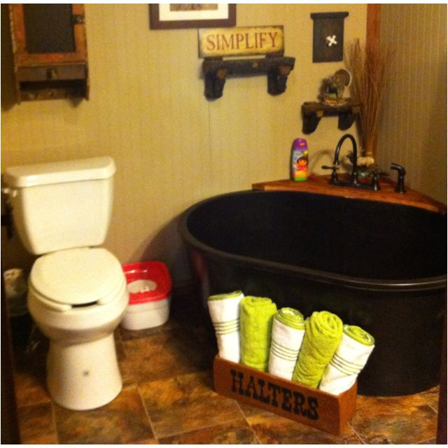 My tub aka a horse trough...we also used a kitchen faucet so that we have a sprayer for the little girls hair :) We <3 it