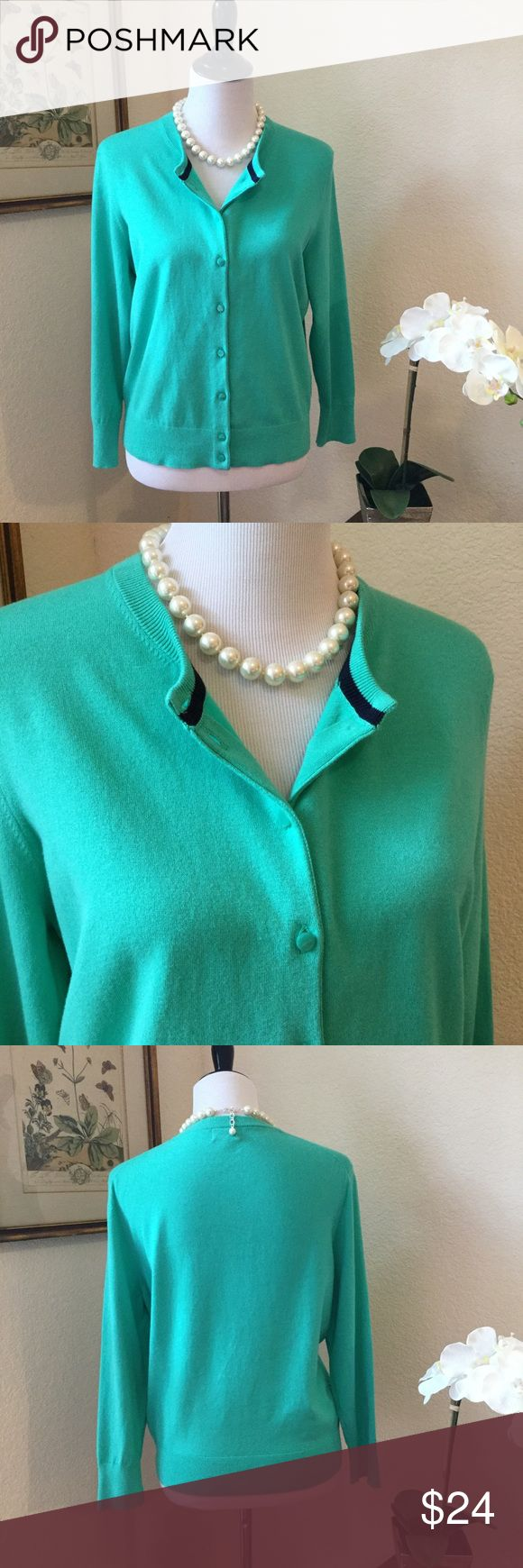 CROWN & IVY Turquoise Cotton Cardigan Charming cotton and spandex turquoise cardigan sweater with navy blue interior trim. This cute lightweight cardi has matching front buttons and long sleeves. In excellent condition. It's an XL, but sized more like a L. Wear year round! Crown & Ivy Sweaters Cardigans