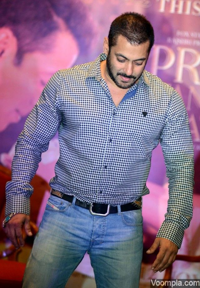 Salman Khan looking smart in a checkered shirt and blue jeans. via Voompla.com