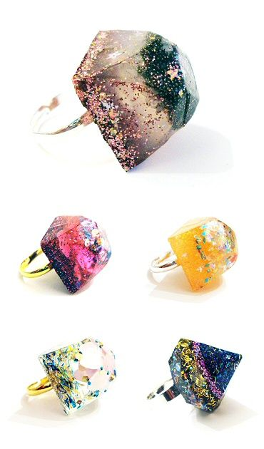 "Goldtone rings with resin ""stones"" infused with glitter"