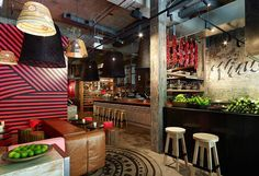 This is a restaurant in Sydney, but what great inspiration for an industrial/global/rustic style kitchen!!