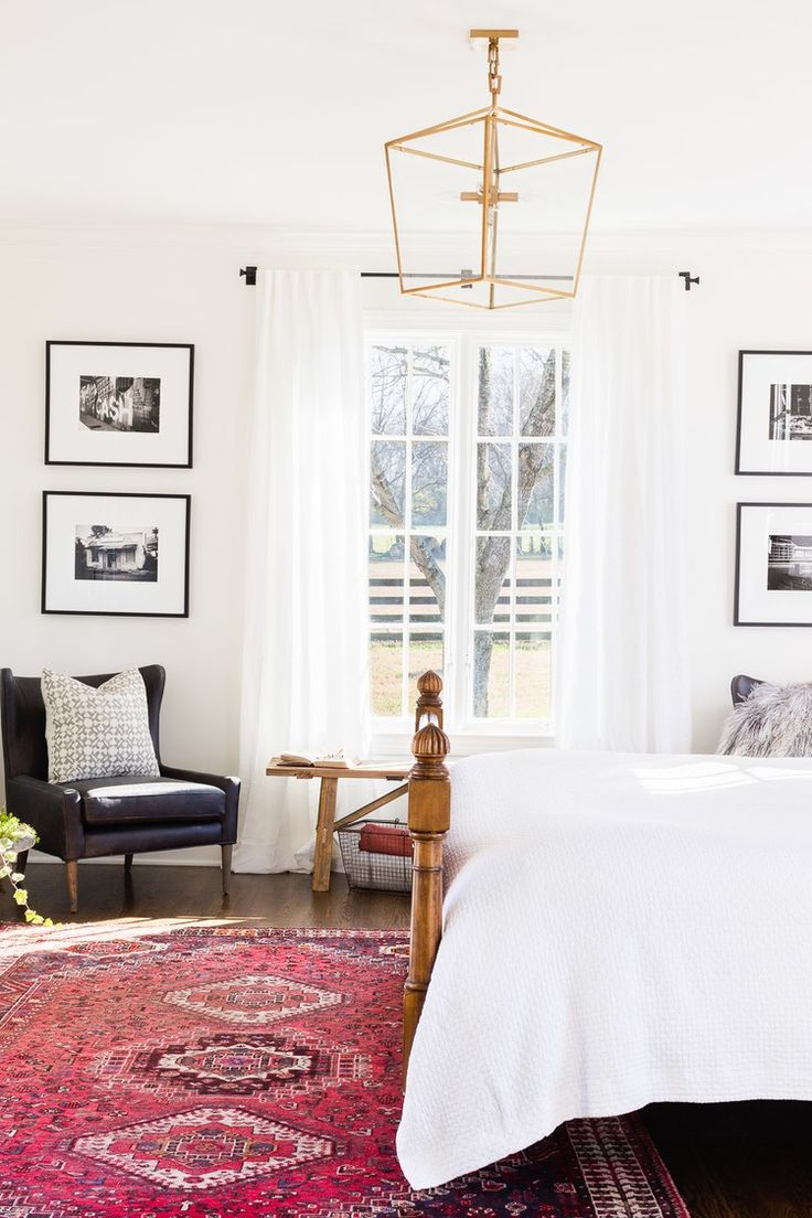A patterned rug and gold accent lighting. Home bedroom
