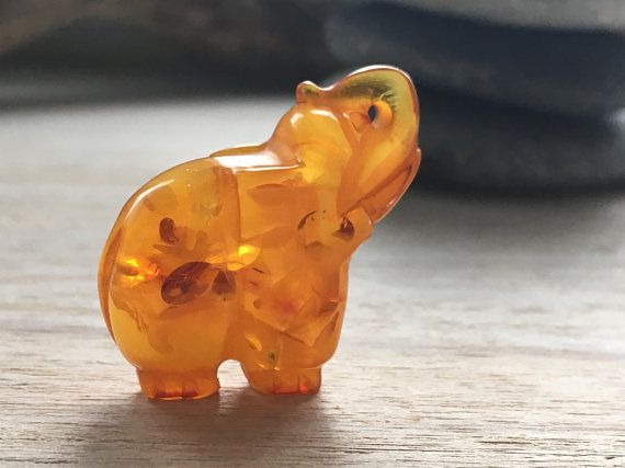 Luck elephant hand carved from amber in honey colour/ Natural