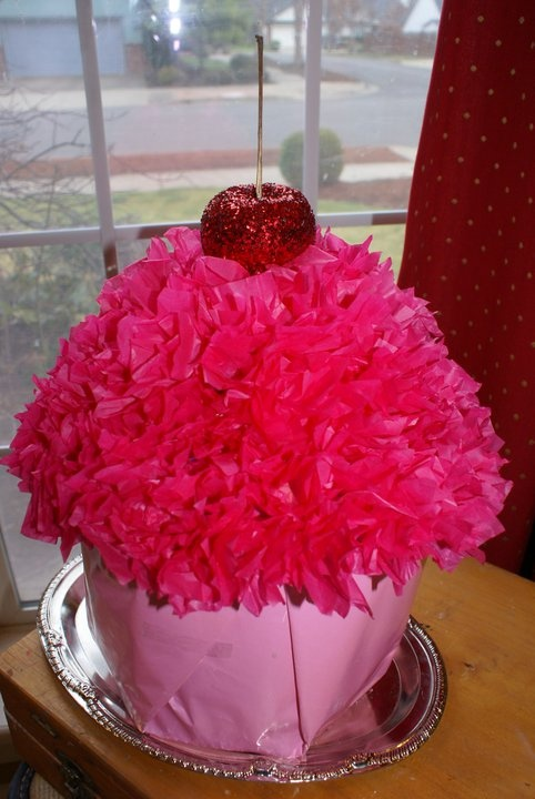 This is a large cupcake Valentine box.  The top opened up for card acccess.  Made out of recycled materials.