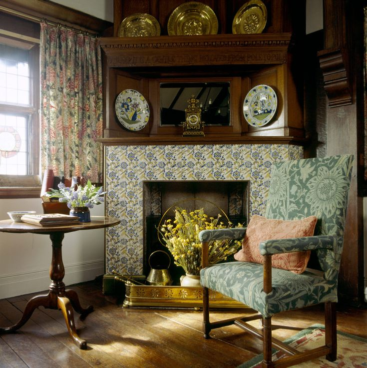 I would love this corner fireplace faced with tiles. Love the brass fender.